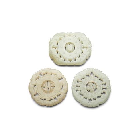 Three jade pendants reticulated with dragon borders (3)