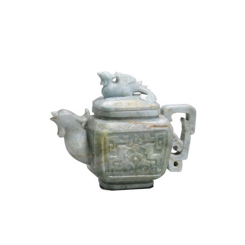 A carved jade ewer and lid (2)