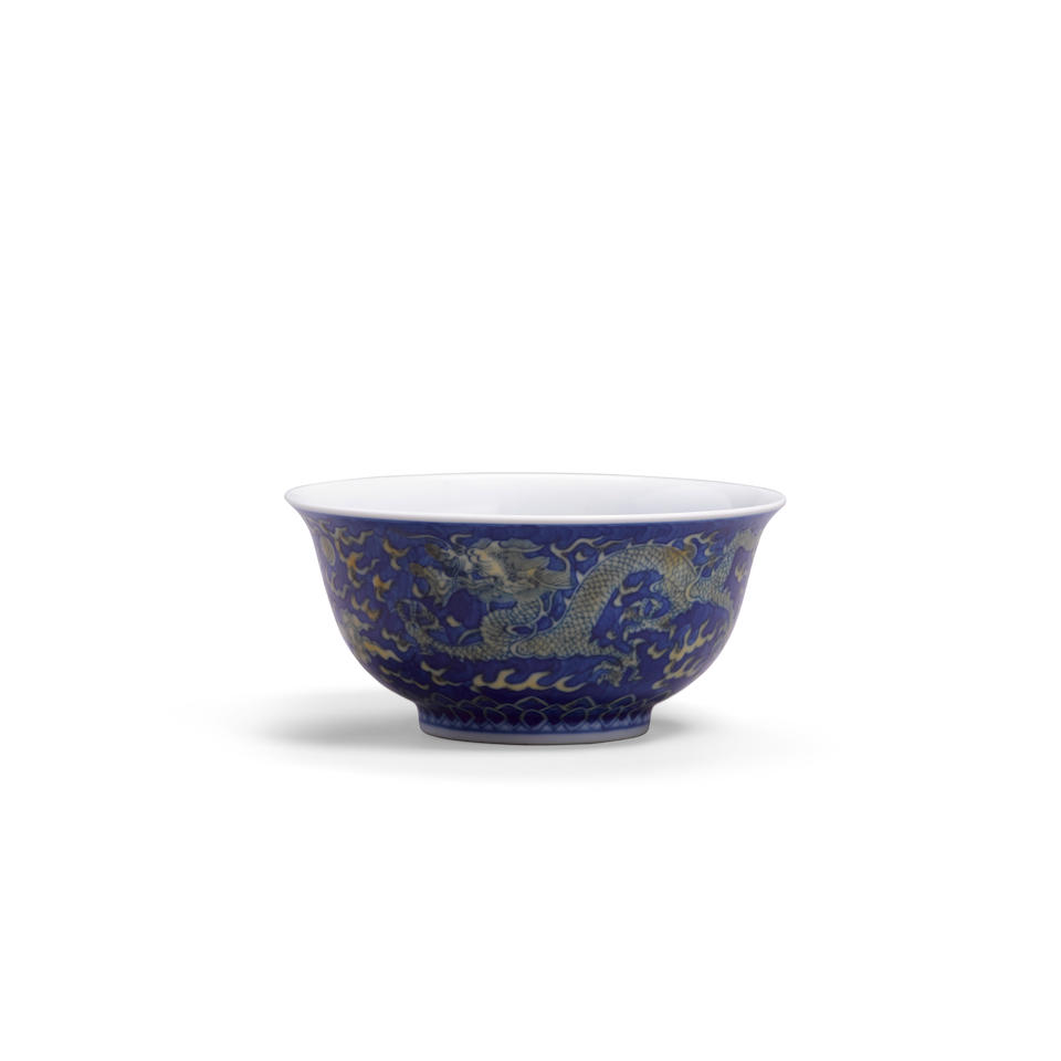 An underglaze blue and yellow enameled dragon bowl Kangxi six-character mark and of the period