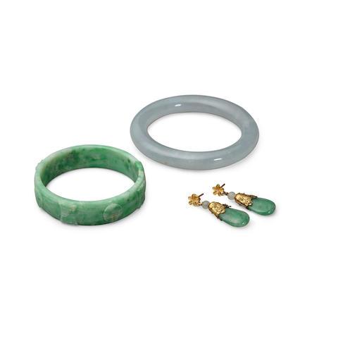 Two jade bangles and one pair of jade earrings (4)