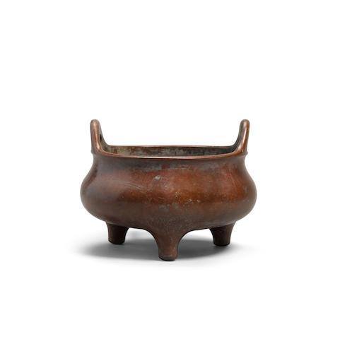 A bronze tripod incense burner 18th/19th century