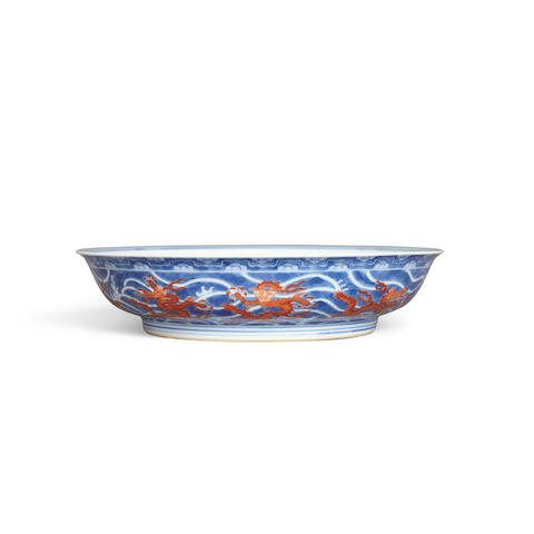 An enameled blue and white dragon dish Qianlong mark
