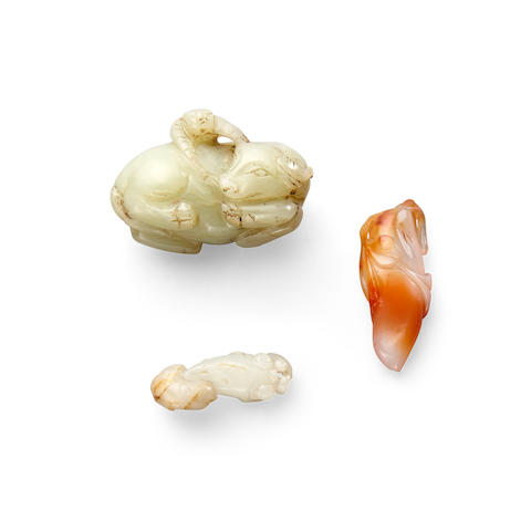 Two jade carvings and a carnelian toggle (3)