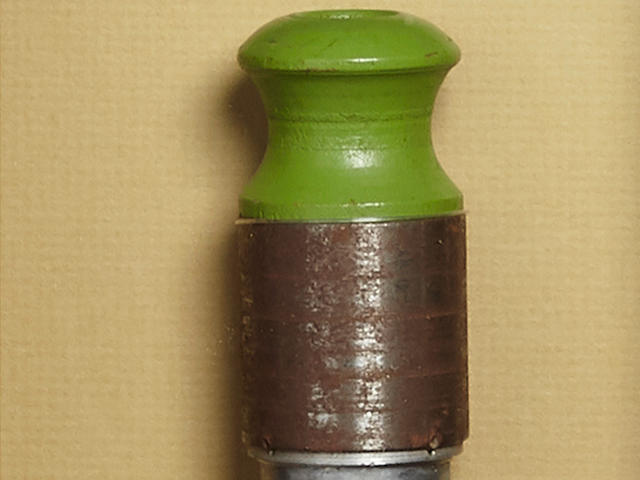"THE DROPPING OF THE FIRST ATOMIC BOMB ON HIROSHIMA. A Green safety plug and a red arming plug from L-11, ""Little Boy"", the First Atomic Bomb dropped on Japan.. Each plug made of composite metal and wood, 3 inches long and 1 inch in diameter, each housed in a custom shadow box with original annotated inspection tags mounted on the reverse. The label for the red plug an inspection card for L-11 signed and dated 7/31/45, and the card for the green plug a written statement signed by both Doll ans Jeppson."