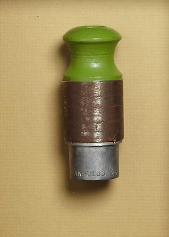 """THE DROPPING OF THE FIRST ATOMIC BOMB ON HIROSHIMA. A Green safety plug and a red arming plug from L-11, """"Little Boy"""", the First Atomic Bomb dropped on Japan.. Each plug made of composite metal and wood, 3 inches long and 1 inch in diameter, each housed in a custom shadow box with original annotated inspection tags mounted on the reverse. The label for the red plug an inspection card for L-11 signed and dated 7/31/45, and the card for the green plug a written statement signed by both Doll ans Jeppson."""