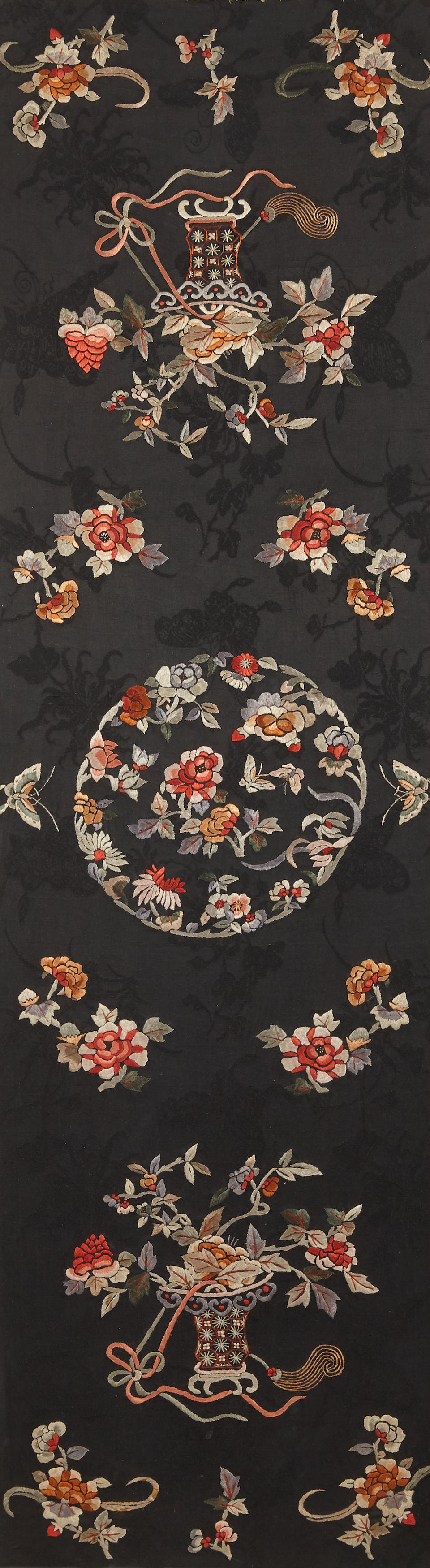 A pair of embroidered black silk panels Circa 1930s (2)