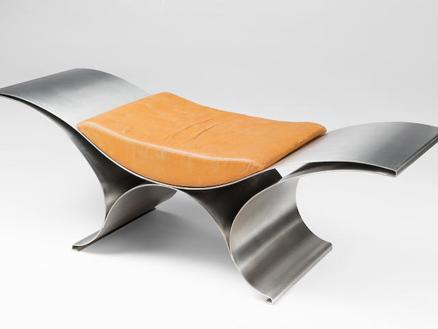 Maria Pergay (born 1930) Wave Bench circa 1970 stainless steel with satin finish, leather upholsteryheight 13in (34cm); width 47 3/4in (121.5cm); depth 15 3/4in (40cm)