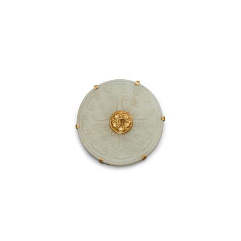 A carved jade bi disc in a gilt metal mount The jade, Late Qing/Republic period