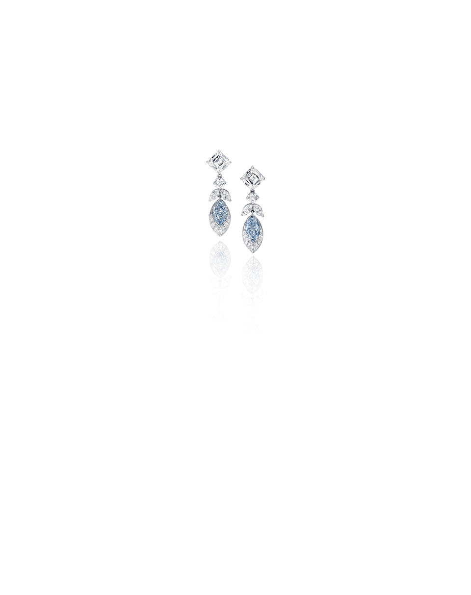 An important pair of fancy colored diamond and diamond earrings