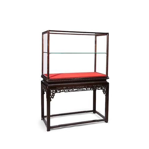 A large glazed hongmu display cabinet on stand