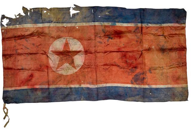 NORTH KOREAN WAR FLAG. North Korea: Inscribed and dated 1950-51.