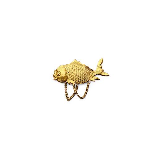 A high karat gold pin