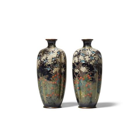 A pair of cloisonné enameled metal vases (2)