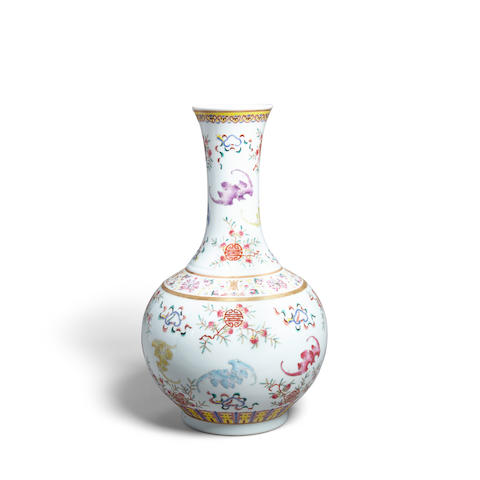 A polychrome enamel decorated porcelain vase  Xuantong mark