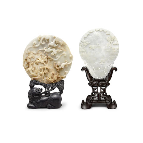Two hardstone plaques of mirror shape (4)