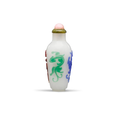 A Four-color overlay opalescent glass 'chilong' snuff bottle Possibly 18th century, attributed to the Imperial Palace Workshops, Beijing