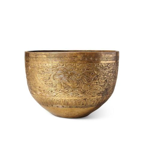 A gilt metal alloy dragon bowl Xuande mark, Late Qing/Republic period