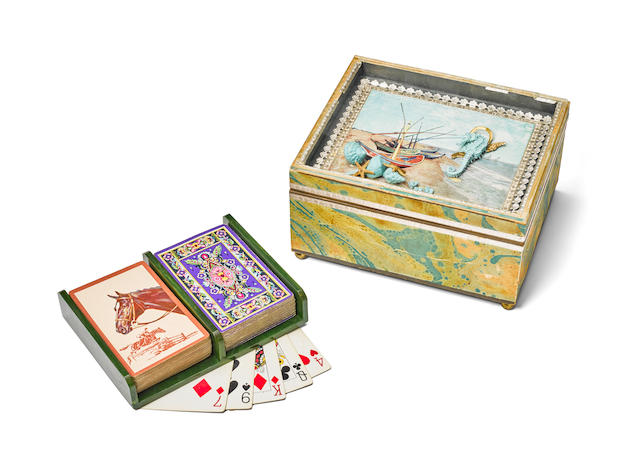JACQUELINE KENNEDY'S NAUTICAL-THEMED ORNAMENTAL BOX.  A small wooden gift box covered in marbled paper, glass-topped shadowbox lid with painted seashore bordered with silver scallop design,