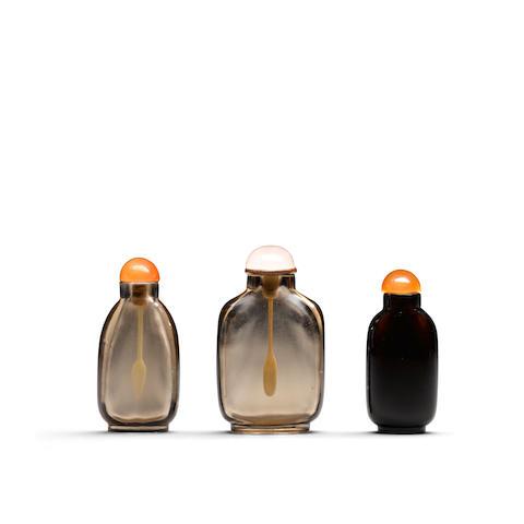 Three rock crystal snuff bottles  (3)