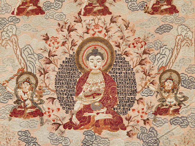 AN EMBROIDERED SILK THANGKA OF THE BUDDHA OF HEALING QING DYNASTY, LATE 18TH/EARLY 19TH CENTURY