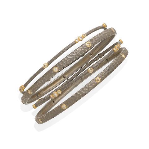 A collection of four diamond bangles