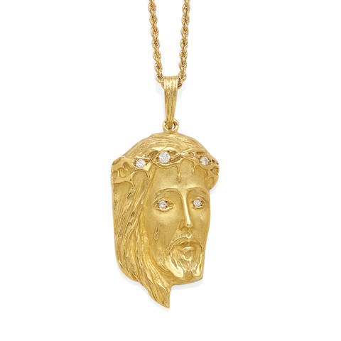 an 18k gold and diamond Christ pendant, French