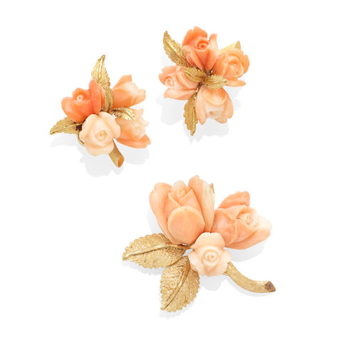 a gold and coral floral brooch and ear clip set