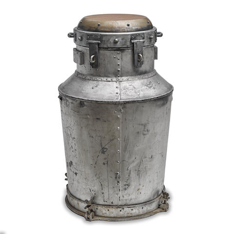 "HOUDINI, HARRY. 1874-1926.  White metal vessel, 35 inches high by 26 inches in diameter at widest, bottom 22 inches in diameter, welded ""milk jug"" with tapered neck, 3 (of 4) wing nut screws at bottom at north, south and east, and two faux hasps at either side of the neck."