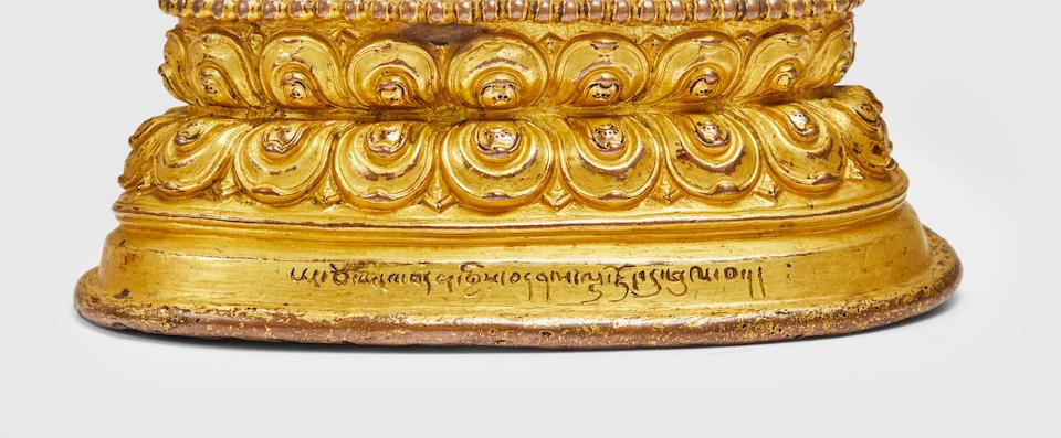 A GILT COPPER ALLOY FIGURE OF SHADAKSHARI LOKESHVARA KHASA MALLA, CIRCA 1300-1350