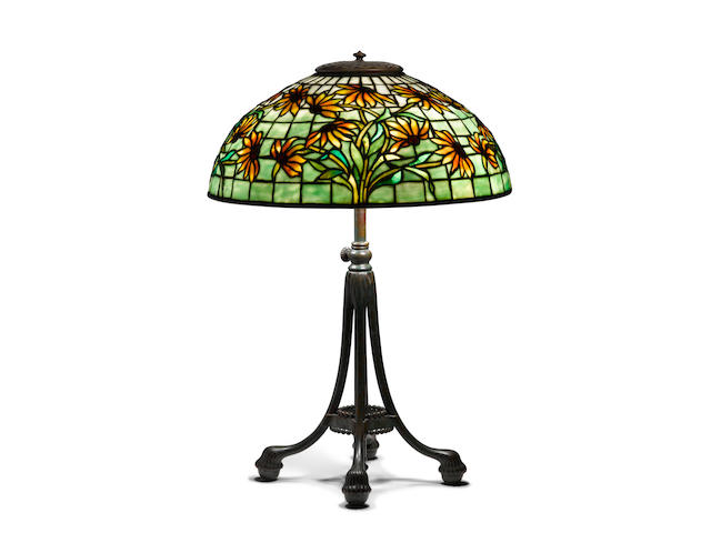 Tiffany Studios (1899-1930) Black-Eyed Susan Table Lampcirca 1910patinated bronze, leaded glass, shade stamped 'TIFFANY STUDIOS NEW YORK 1447-19'height 23in (58.4cm); diameter of shade 16in (40.6cm)