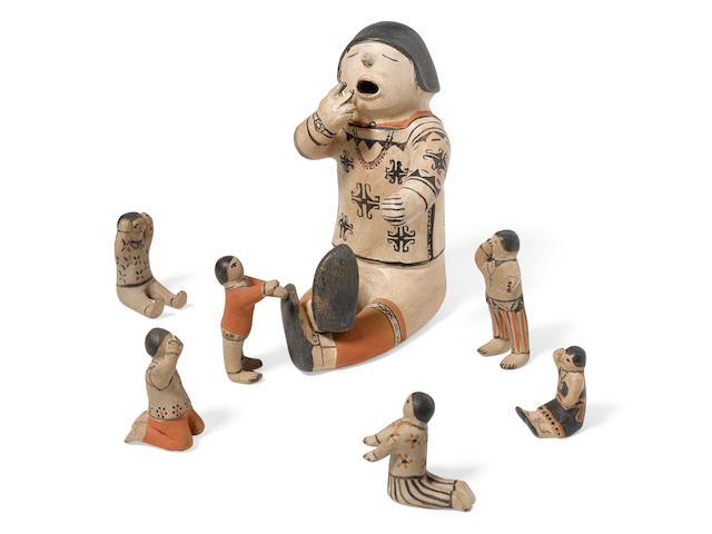 A Helen Cordero pottery storyteller figural group