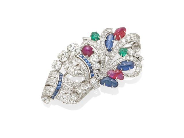 A diamond and colored stone dress clip, Raymond Yard