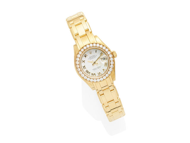 A gold and diamond 'pearlmaster' wristwatch, Rolex