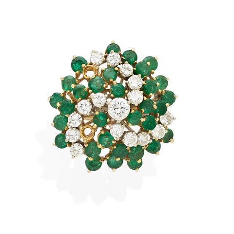 an emerald and diamond bombe ring