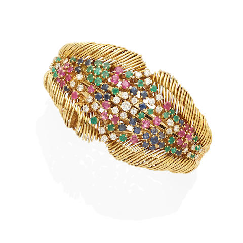 a gold, diamond and colored stone bangle