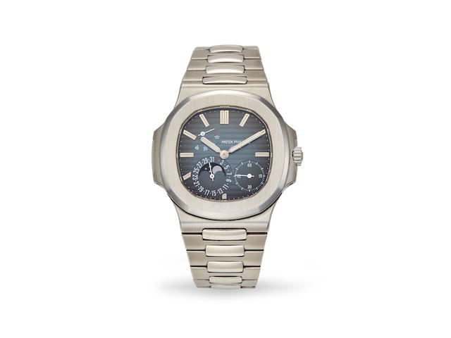Patek Philippe. A fine stainless steel automatic calendar bracelet watch with moon phase and winding indicator Nautilus, Ref: 5712/1A-001, 2007