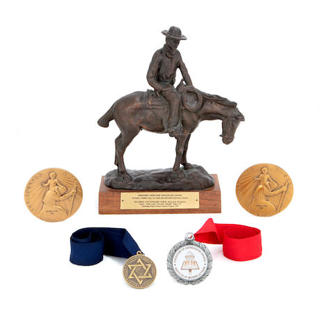 An Edward and Mildred Lewis Western Heritage Wrangler Award and other awards