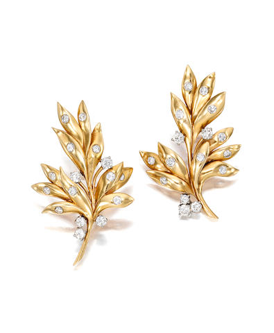 A pair of 14k gold and diamond clip brooches, Cartier,