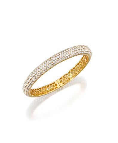 An 18k gold and diamond bangle