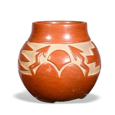 A Santa Clara carved redware jar, attributed to Margaret Tafoya