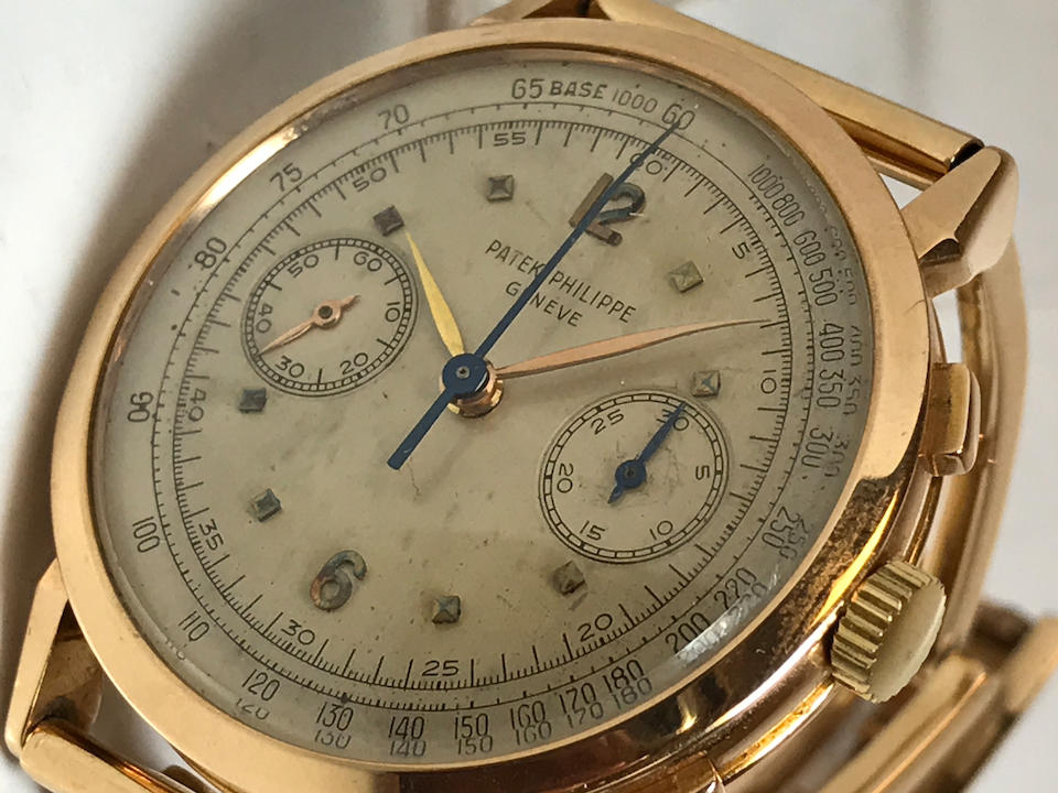 Patek Philippe. A fine and rare 18K rose gold manual wind chronograph bracelet watch Ref: 1579, Sold 19th January 1954