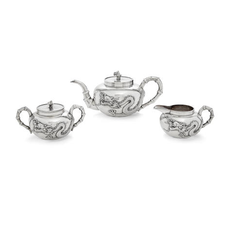 A CHINESE SILVER THREE-PIECE TEA SET by Wang Hing & Co., Hong Kong, late 19th/early 20th century