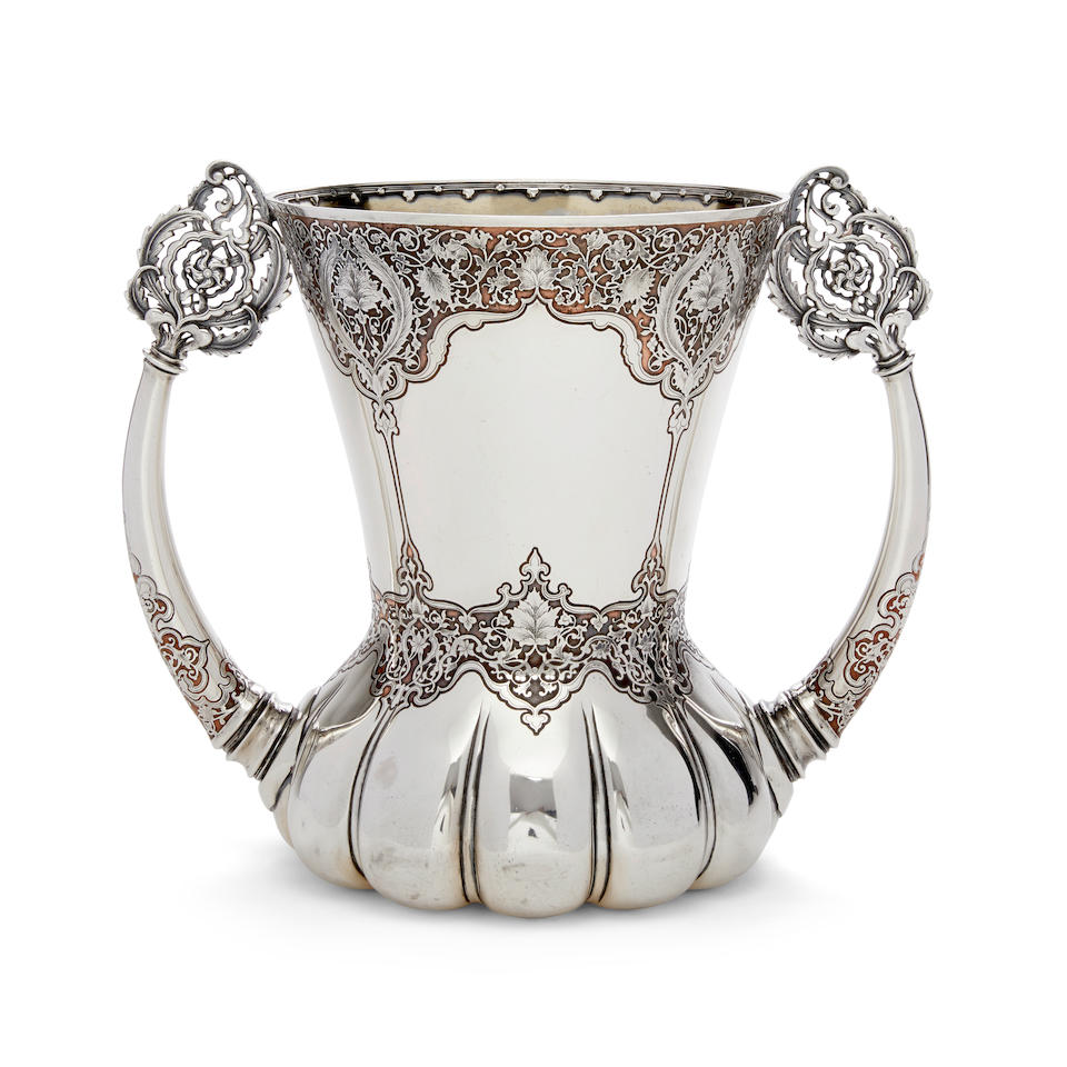 AN EXCEPTIONAL STERLING SILVER AND COPPER LOVING CUP by Tiffany & Co., New York, NY, marked 10209 Makers 3350, 1902-1907