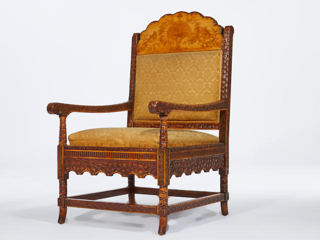 Louis C. Tiffany (1848-1930) for L.C. Tiffany & Co. Important Armchaircirca 1879from the salon of the George Kemp House, New Yorkcarved holly inlaid with other woods, silk upholsteryheight 42in (107cm); width 24in (61cm); depth 27in (69cm)