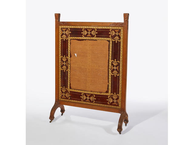 Isaac Scott (1945-1920); Attributed to  Large Floor Screencirca 1885carved oak, leather, needlework, on castersheight 70 1/2 inches (179cm); width 48 inches (121cm); depth 17 inches (43cm)