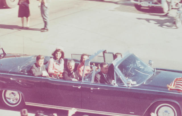 ONE OF THE LAST PHOTOGRAPHS OF JFK. Color photographic print of the Kennedys and Connallys leaving Love Field,