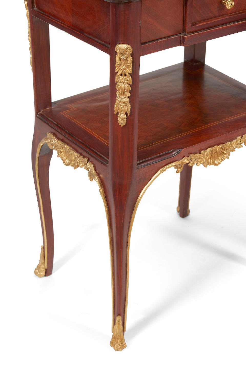A pair of transitional Louis XV/XVI style gilt bronze mounted parquetry side tables