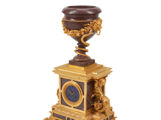 A Louis XVI style gilt bronze mounted Porphyry and Lapis mantel clock