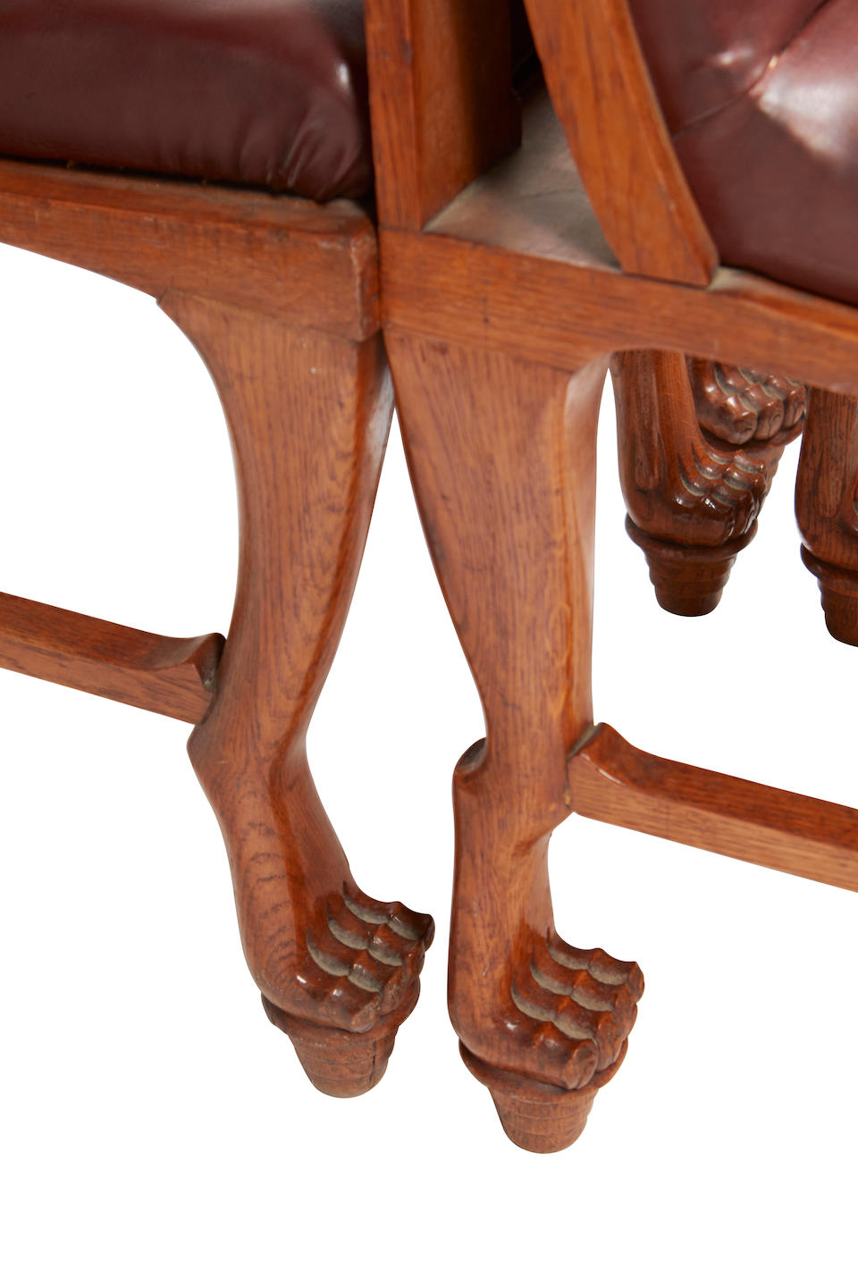 An Arts & Crafts Egyptian Revival carved oak dining suite Early 20th century