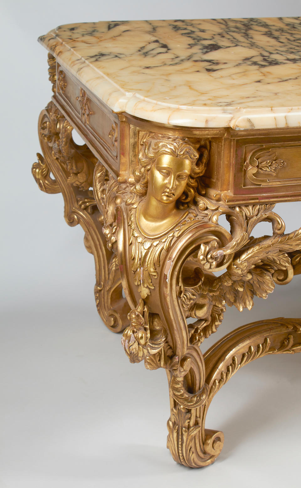 An Italian Rococo Style Marble Top Giltwood Center Table
